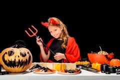 Ребенок с украшениями и помадками хеллоуина Стоковое Изображение