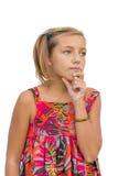 Ребенок думает о наученном решении Стоковые Изображения RF