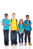 Ребеята школьного возраста на белизне стоковые фото
