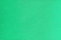 Ребристая текстура зеленого картона с горизонтальными прямыми иллюстрация штока