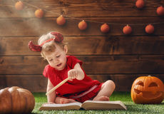 Ребёнок в костюме дьявола Стоковые Изображения