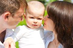 ребёнок его родители Стоковое Изображение