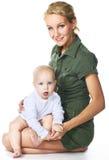 ребёнок ее мать удерживания стоковые изображения