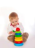 ребёнок играя игрушки Стоковое фото RF
