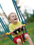 ребёнок играя качание стоковое фото rf