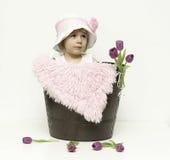 Ребёнок и тюльпаны Стоковая Фотография RF
