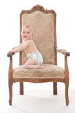 Ребёнок на античном стуле Стоковое Изображение