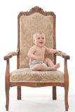 Ребёнок на античном стуле Стоковые Фотографии RF