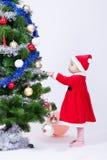 Ребёнок рождества в крышке Санта Клауса Стоковые Фотографии RF