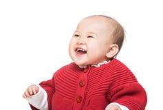 ребёнок смеясь над немного стоковая фотография