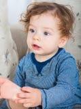 Ребёнок с вьющиеся волосы Стоковое Изображение RF