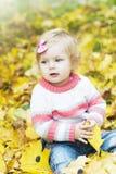 Ребёнок с листьями осени Стоковое Изображение