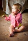 Ребёнок с томатом Стоковая Фотография