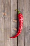 древесина красного цвета горячего перца chili предпосылки Стоковое Изображение