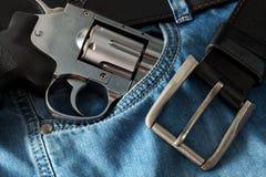 Револьвер и джинсы Стоковые Изображения