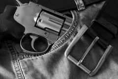 Револьвер и джинсы Стоковые Изображения RF