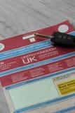 Регистрационный журнал автомобиля V5C с электронным ключом обманывает Стоковое Фото
