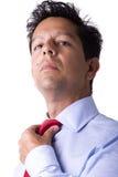 регулирующ бизнесмена его галстук Стоковая Фотография