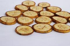 Режут зрелые бананы совместно на белой предпосылке Стоковые Фото