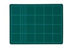 резать зеленую циновку Стоковое фото RF