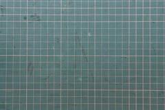 резать зеленую циновку Стоковая Фотография RF