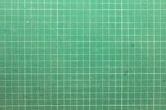 резать зеленую циновку Стоковая Фотография
