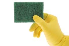 Резиновая перчатка и зеленая губка Стоковые Фотографии RF