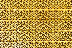 Резиновая текстурированная циновка золотого цвета стоковые фотографии rf