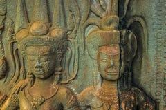 Резное изображение в стенах Angkor Wat, Камбоджи стоковые фотографии rf
