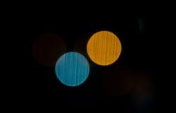Резюмируйте запачканные света выглядеть как планеты на темной предпосылке Стоковая Фотография RF