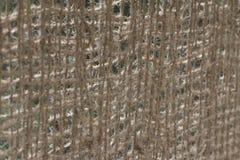 Резюмируйте запачканный взгляд прикрепленного на петлях моста с рельсом веревочки кокоса Стоковые Изображения