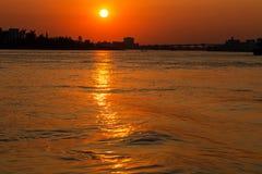 Река в заходе солнца стоковое фото