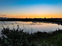 Река захода солнца Стоковая Фотография