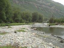 Река и побережье камня Стоковая Фотография