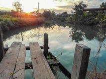 Река среди поля стоковая фотография rf
