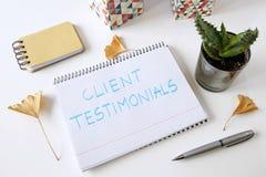 Рекомендации клиента написанные в тетради стоковое изображение rf