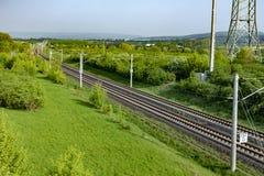 Рельсы в сельском ландшафте для немецкого быстроходного поезда междугородного e Стоковое Изображение