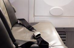 Ремень безопасности концепции безопасности на самолете Стоковые Фото