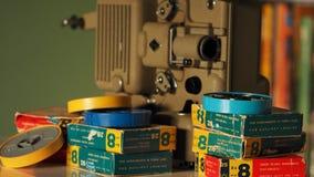 репроектор 8 mm бежать с винтажным фильмом стоковое изображение rf