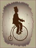 Ретро велосипед и джентльмен Стоковое Изображение