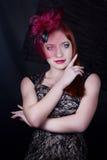 Ретро девушка с крышкой burgundy Стоковое фото RF