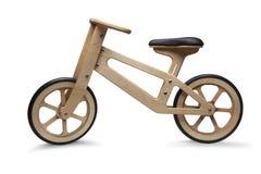 Ретро деревянный велосипед детей стоковое изображение