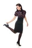 Ретро женщина подняла ее владения ноги пятка стоковое фото
