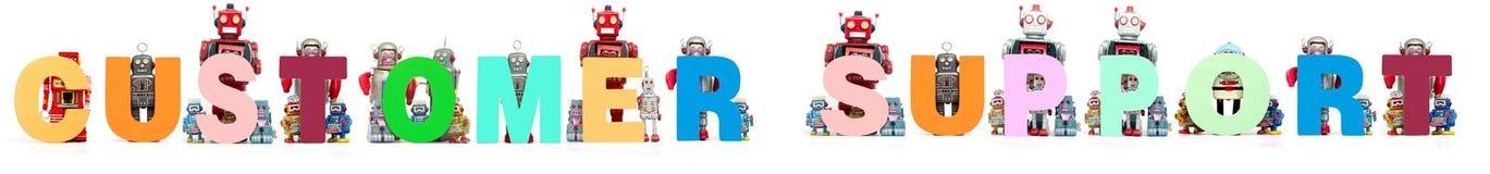 Ретро игрушки робота олова задерживают слово РАБОТУ С КЛИЕНТОМ стоковые фотографии rf