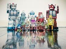 Ретро роботы с подарками на старом деревянном поле стоковое фото rf