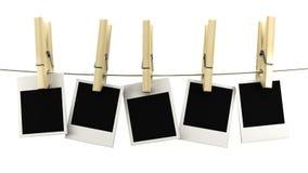 Ретро смертная казнь через повешение рамки фото на веревочке на деревянных зажимках для белья Стоковая Фотография