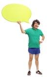 Ретро спортсмен держа пузырь речи Стоковые Фотографии RF