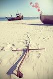 Ретро фото стиля анкера на пляже Стоковые Фото