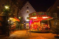 Ретро carousel - городок рождества баварский в вечере Стоковая Фотография RF
