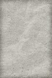 Рециркулируйте бумажное с белого дополнительного образца текстуры Grunge виньетки грубого зерна скомканного Стоковое Фото